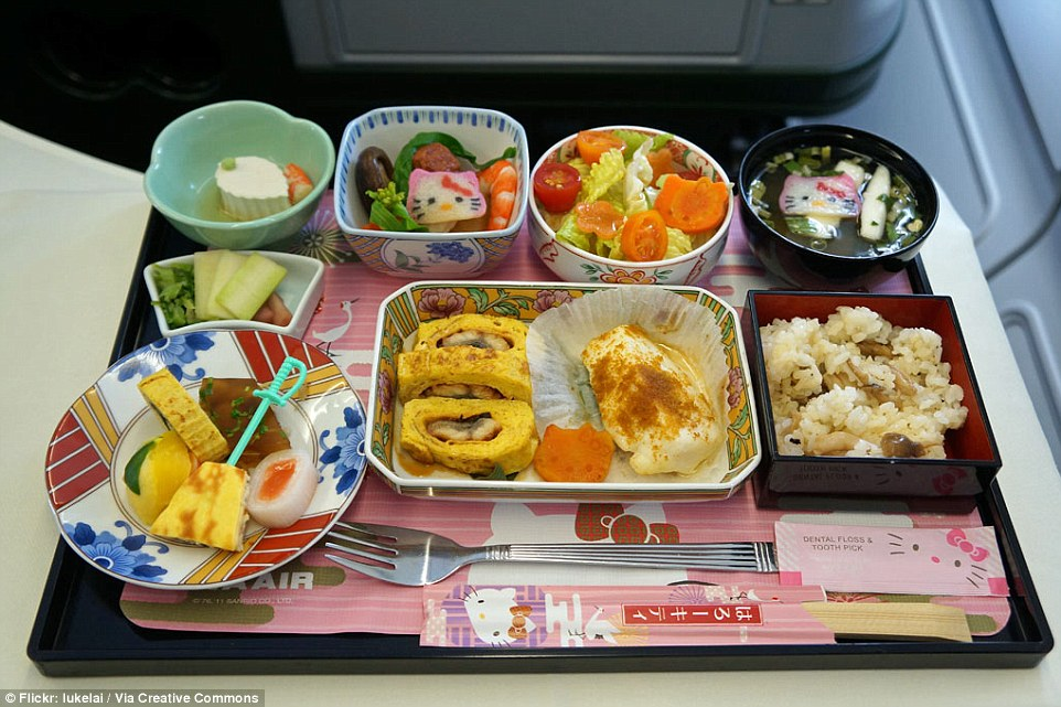 Taiwan's EVA Airways Hello Kitty jet serves an adorable business breakfast set of tofu, miso soup, tomato and vegetable salad, tamagoyaki (Japanese omelette), rice, pickles, and prawns with broccoli and mushrooms