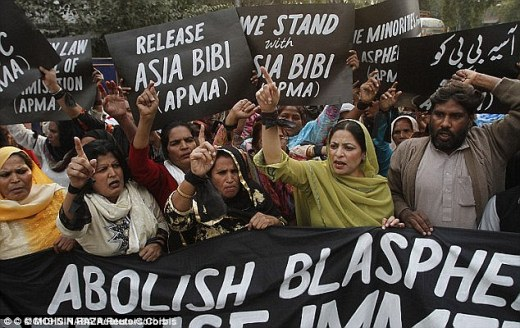 Anger: Protesters hold up placards while demanding the release of Mrs Bibi at a rally in Lahore in 2010