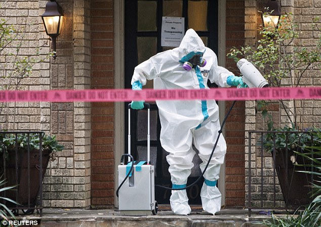 The distinctive full body Hazmat  suits with their protective masks have become a symbol of the epidemic