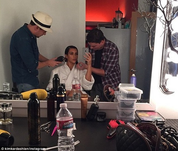 Makeover time: The reality star followed it up with a snapshot of her glam squad working on her hair and make-up