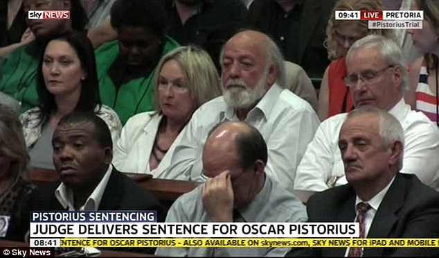 Strain: Reeva Steenkamp's parents, June and Barry Steenkamp (back centre), listen to the judge summary of the case before she hands down sentence to Oscar Pistorius for killing their daughter