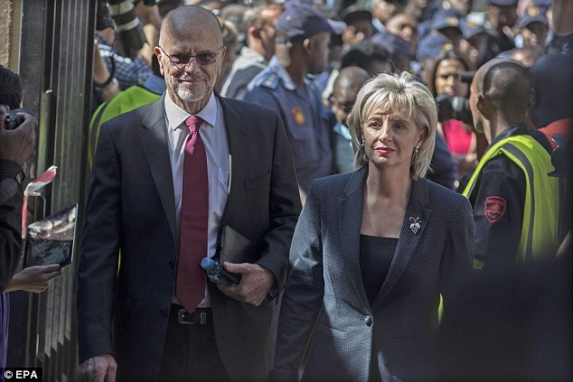 Support: Oscar Pistorius's uncle Arnold and aunt Lois  arrive at the High Court for the final day of the sentencing