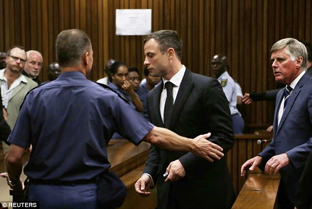 Led away: Pistorius could spend only ten months in jail and, provided he poses no trouble to the prison authorities, could spend the remainder of his sentence under correctional supervision at home