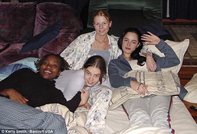 Hanging out: Miss Steenkamp (right) pictured with friends Chuma (left), Nadia (front) and Joelene (back) during a sleepover at friend Kerry Smith's house in Port Elizabeth, South Africa in 2003