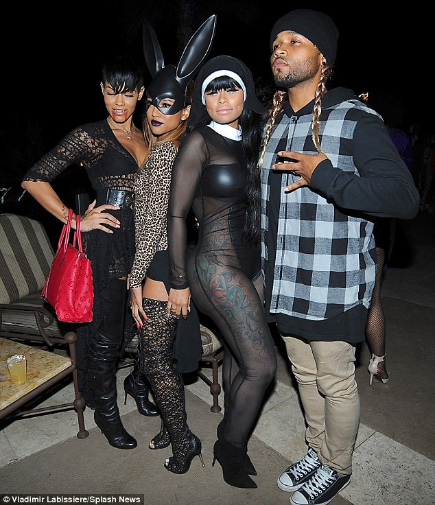 Attention-grabber: Blac Chyna, whose real name isAngela Renee White, posed in the middle of a group of pals