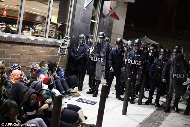 Response: Police have donned riot gear to meet the protesters in ugly confrontations