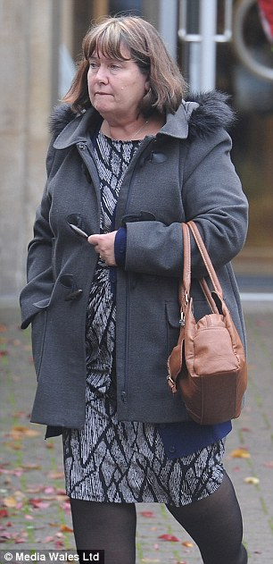 Heather Woodfield, 61, (pictured outside the Nursing and Midwifery Council tribunal in Cardiff) failed to seek medical assistance for the unconscious patient