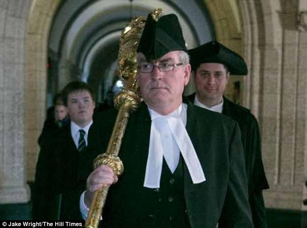 Armed: Sergeant-at-Arms<br /><br /> Kevin Vickers, pictured carrying out his ceremonial mace carrying function, shot dead Zehaf-Bibeau