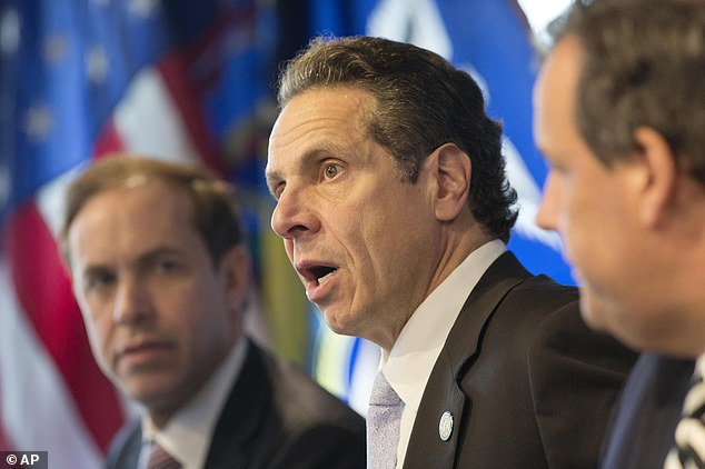 New York Gov. Andrew Cuomo (center) says he doesn't know how his 'mandatory' quarantine would be enforced
