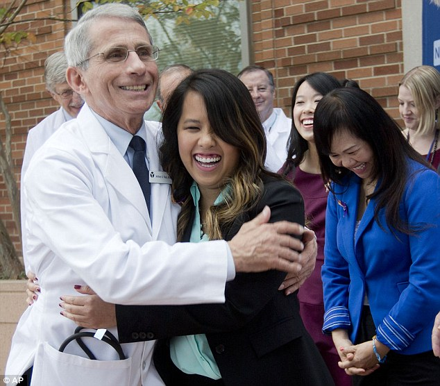 Patient Nina Pham is hugged by Dr. Anthony Fauci, director of the National Institute of Allergy and Infectious Diseases, outside of National Institutes of Health (NIH) . Pham, the first nurse diagnosed with Ebola after treating an infected man at a Dallas hospital is free of the virus.
