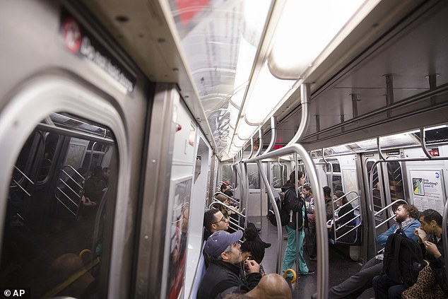 Commuters ride inside an L train subway car. This is the same train line that Dr. Craig Spencer, a Doctors Without Borders physician who tested positive for the Ebola, had taken to visit a bowling alley in Brooklyn