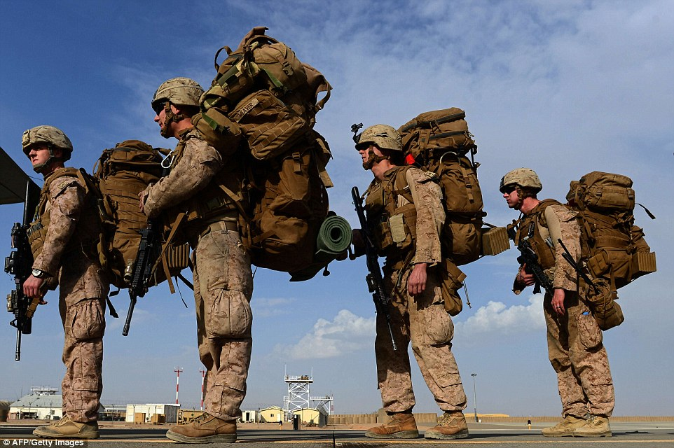 Over a decade of war: US Marines board a C-130J Super Hercules transport aircraft headed to Kandahar as they prepare to head home 13 years after U.S.-led forces invaded Afghanistan to stop the Taliban