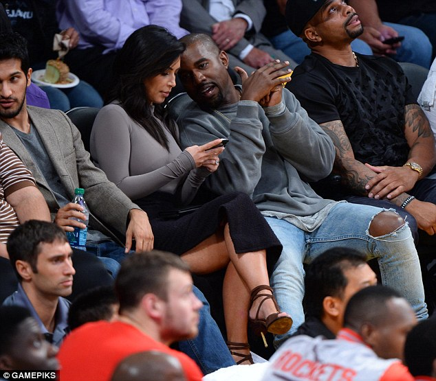 Social media addict: Kim was busy checking her Twitter feed, which is followed by a whopping 24.8 million people, and her Instagram account, which boasts 20.5 million followers