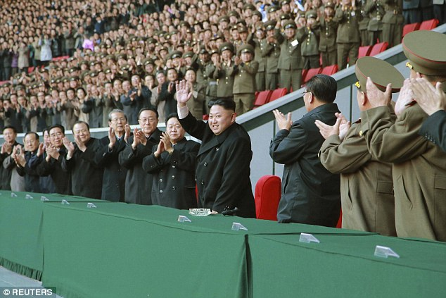 Cheered on: The women's football game saw the North Korean team meet a team from national team and the Wolmido, an island just south of the border to South Korea