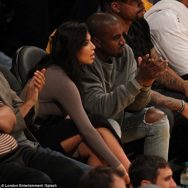 Wardrobe malfunction: Kim Kardashian accidentally flashed her Spanx during the LA Lakers game at the Staples Center in Los Angeles on Tuesday night, where she sat courtside with her husband Kanye West