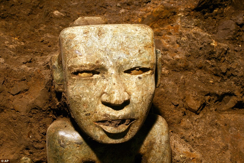 A sculpture unearthed at the Teotihuacan archeological site in Mexico. The city reached its peak between 100 B.C. and 650 B.C. witha population as large as 200,000, growing rich from awide-ranging trade in obsidian that in pre-Colombian times wasused to make knives and other weapons.