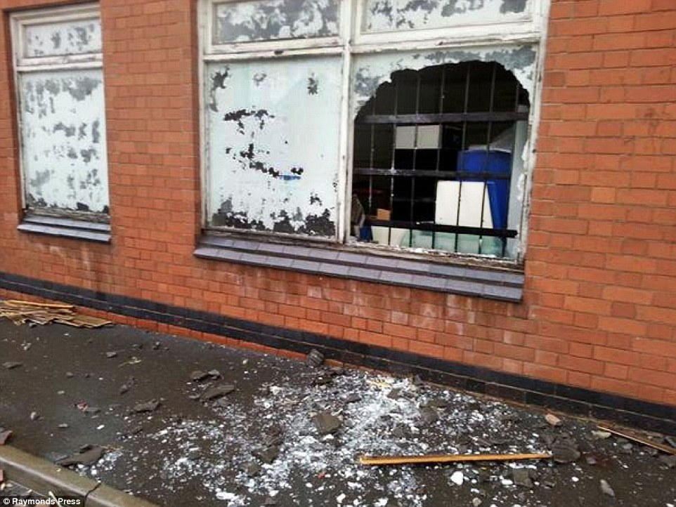 Smashed:Several buildings had their windows shattered. Teams of council workmen were sent in to help with the clear-up job