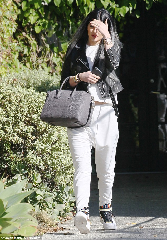 Pampering time: Kylie went in for some hair care treatment at the Andy Lecompte Salon in LA on Monday