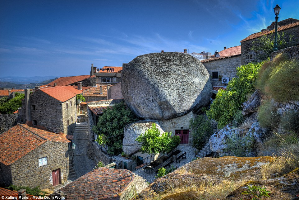 'I like that boulder. That is a nice boulder': Villagers in Monsanto, Portugal have made their homes around ancient boulders
