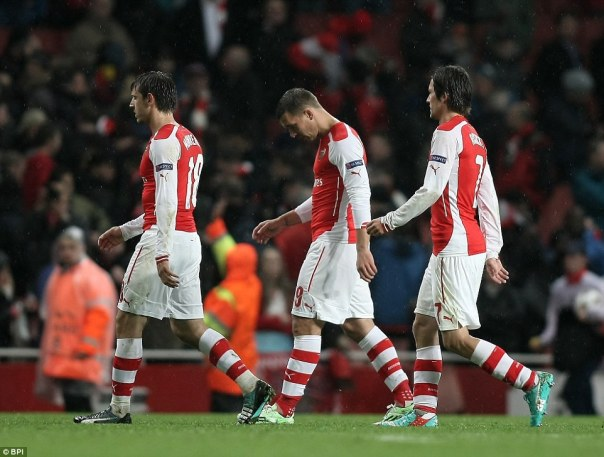 Nacho Monreal, Lukas Podolski and Tomas Rosicky (left to right) trudge off the pitch after Arsenal are embarrassed
