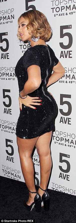 Curves in all the right places: The 17-time Grammy Award winner displayed her derriere in the short frock