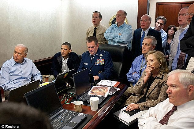 Mission: Senior White House figures including vice-president Joe Biden (far left) and then Secretary of State Hillary Clinton, joining President Obama to watch the mission in Pakistan unfold. O'Neill fired three bullets into bin Laden's head, killing him instantly