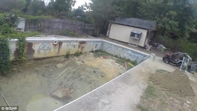 An empty pool outside the home boasts yet another Pentagram