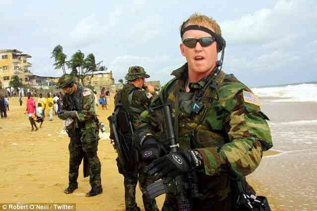 Team member: A picture of O'Neill as a serviceman shows him in uniform in Liberia, where the Navy was involved in operations to stabilize the war-torn country