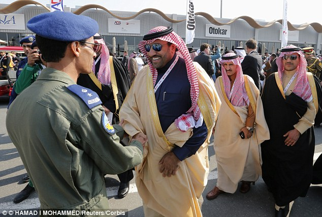 The former Labour Party leader signed the deal with PetroSaudi, which was co-founded by the son of the King  of Saudi Arabia - Prince Turki bin Abdullah Al Saud (pictured centre, shaking hands)