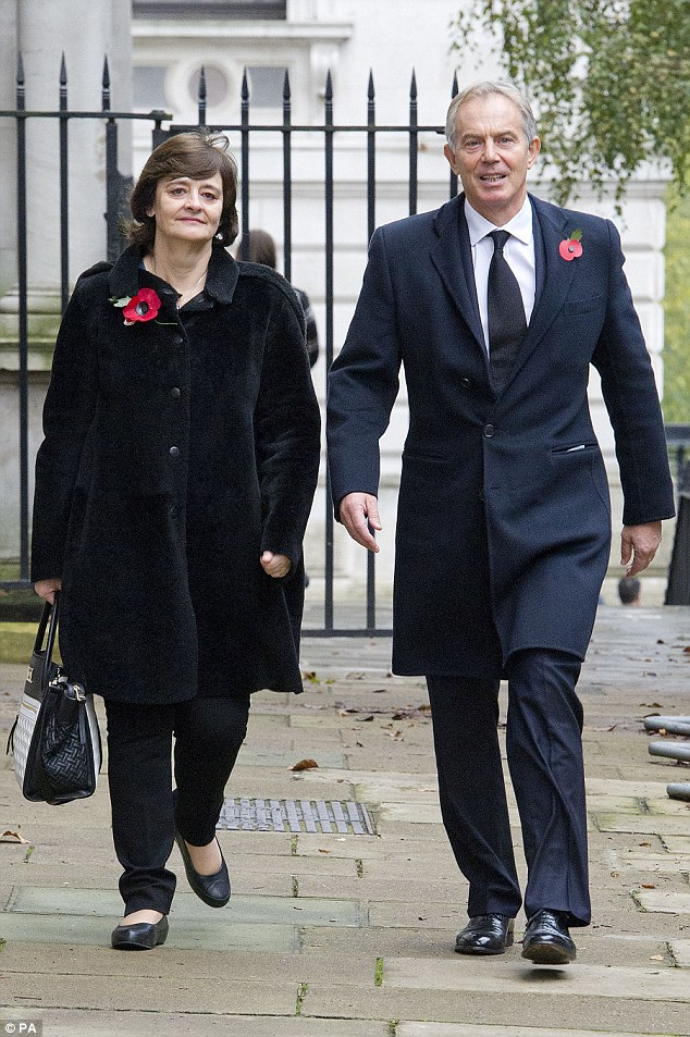 Tony Blair and his wife Cherie, pictured today walking through Downing Street on their way to the annual Remembrance Sunday service at the Cenotaph memorial in Whitehall, London