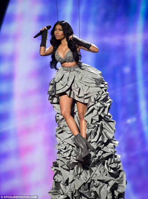 Hitting the stage: Show host Nicki Minaj was lowered onto the stage on Saturday night with her 14ft train below her