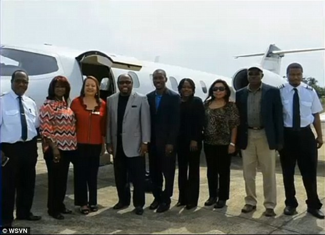 Final picture: Dr Myles Munroe, left of center in a gray jacket, poses with his wife, second left, and members of their congregation. The picture was taken two years ago
