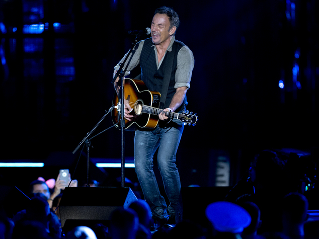 Standing alone with an acoustic guitar, Bruce Springsteen played a ruminative version of Born in the U.S.A., his own song about a disillusioned Vietnam veteran
