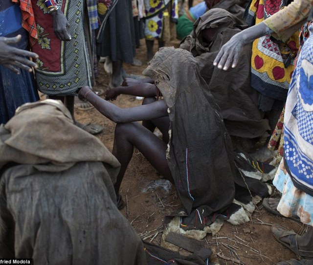 Naked Draped In Animal Skins The Pokot Girls Sit Naked On Rocks Before Village