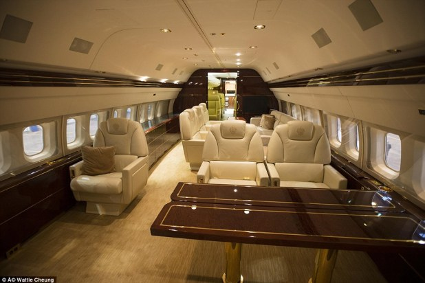 Luxury: Sleek cream seating is finished with 24-carat gold seat belt buckles and glossy walnut tables
