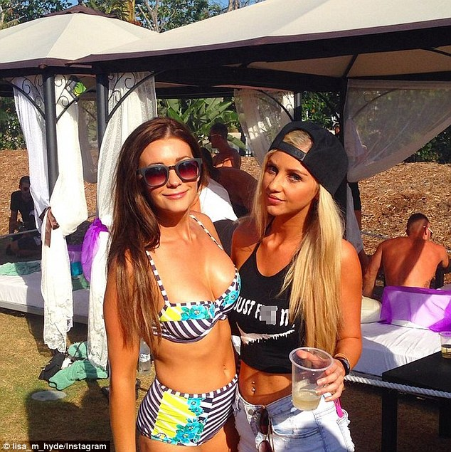 Bosom buddies: Lisa sported a glowing tan from her rceent trip to Vietnam with Sam, and posed with DJ Brooklyn