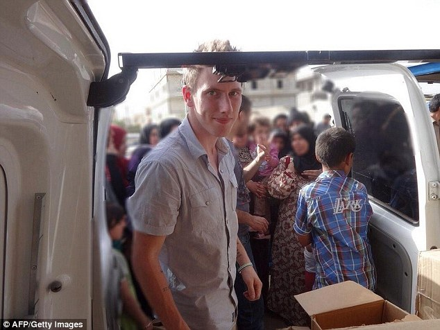Aid: Mr Kassig in front of a truck somewhere along the Syrian border between late 2012 and autumn 2013
