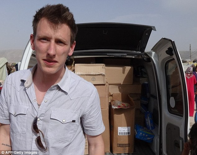 Murdered: President Barack Obama today paid tribute to American aid worker Peter Kassig (pictured) as an ISIS video purporting to show a militant standing above his severed head was confirmed as genuine