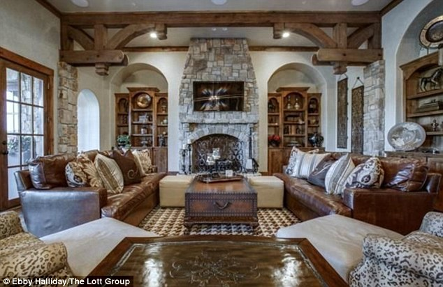 Wood charm:After stepping through a foyer guests then head into a sunken expansive living area that has been made to feel homey thanks to the combination of stonework sections, beams and wood floors