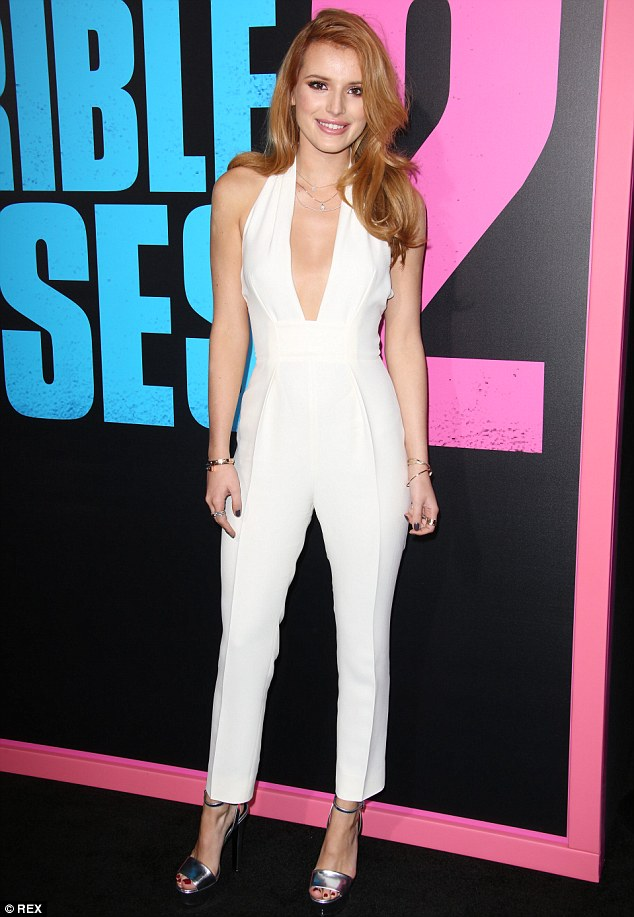 Bella Thorne Dazzles In A Backless White Jumpsuit As She