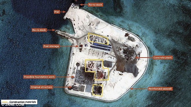 Workers had built a reinforced seawall around an island on Johnson South Reef in the Spratly Islands by August (pictured)