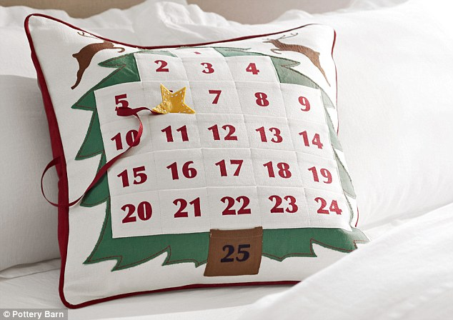 Cuddle up: Pottery Barn's advent calendar pillowcase ($59) doubles up as a form of festive decor