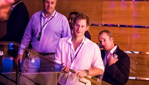 Royal seal of approval: Prince Harry, who had been in the Mercedes garage earlier in the day and branded the driver a 'legend' following his win, also attended the glitzy bash surrounded by security