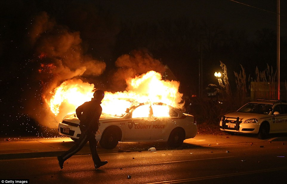 Blaze: Police warned protesters Monday night to stay away from burning police cars which contain live ammunition. Officers used tear gas to try to disperse some of the gatherings