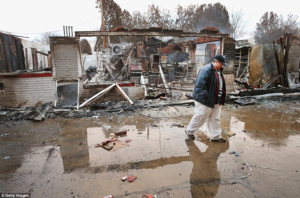 Devastated: A gas station was among the targets of the violence. Today property manager Terri Willits witnessed the destruction