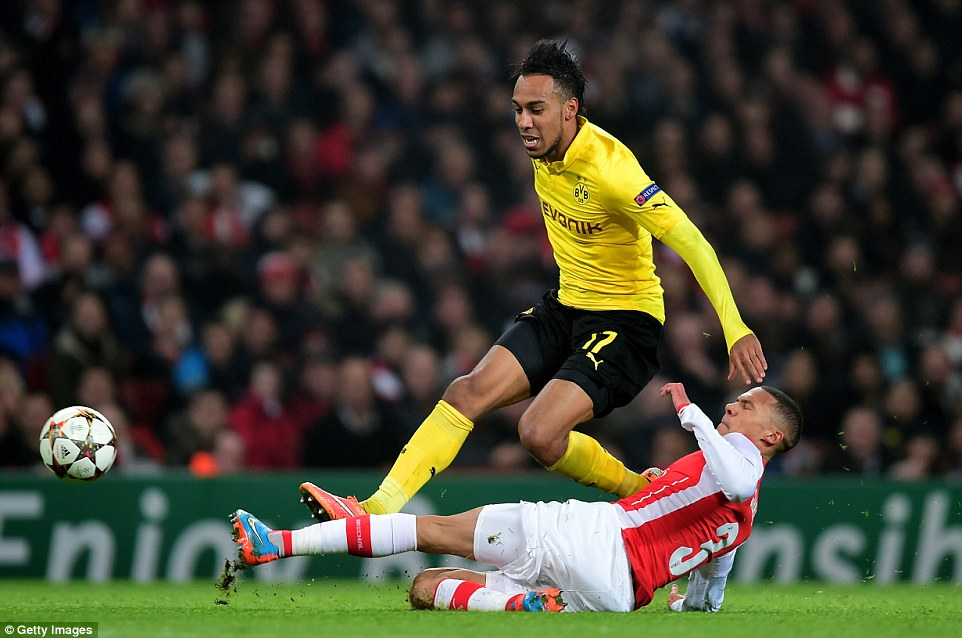 Pierre-Emerick Aubameyang is tackled by Gibbs during the Champions League Group D clash