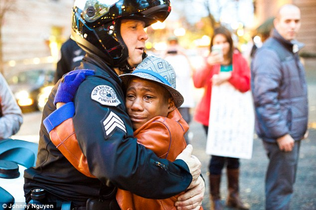 Emotional: During an emotional rally in Portland, Oregon, a 12-year-old black boy, Devonte Hart, with tears in his eyes, embraced a white police officer, Portland Police Sgt. Bret Barnum
