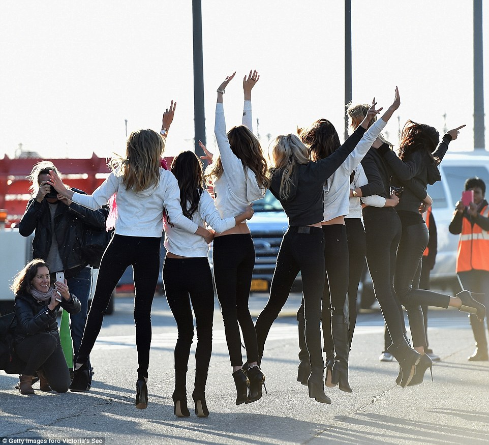 Jumping for joy: Before they could start their journey the supermodels posed for numerous photos
