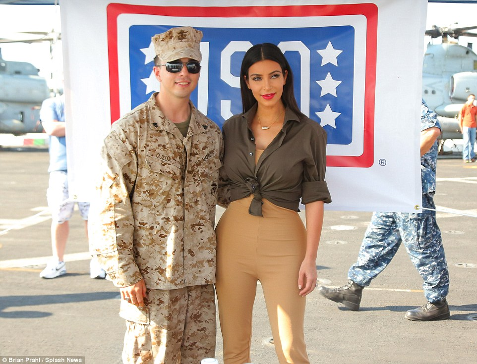 Reality star: Kim appeared down to earth as she happily chatted and joked with the servicemen and women on board USS San Diego