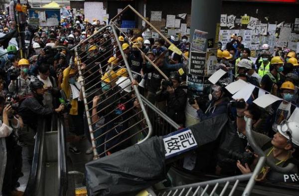 Hong Kong leader says protests 'in vain' after violent ...